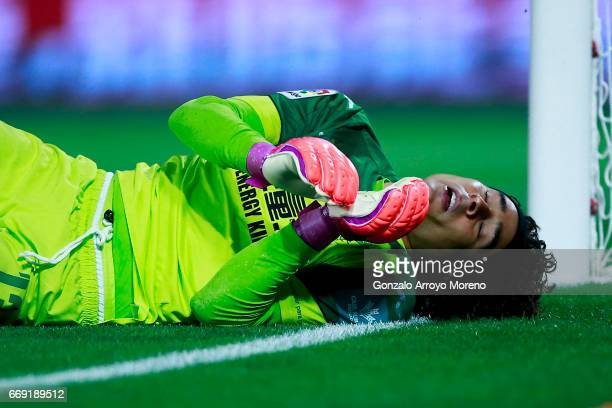 Goalkeeper Francisco Guillermo Ochoa of Granada CF falls after failing to stop Marcelo Diaz' strike during the La Liga match between Granada CF and...