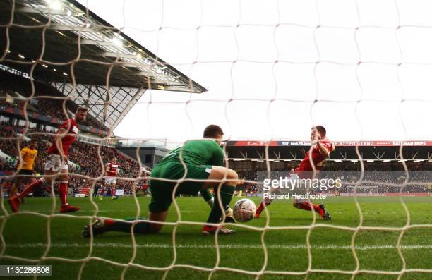 Goalkeeper Frank Fielding and Tomas Kalas of Bristol City fail to stop Ivan Cavaleiro of Wolverhampton Wanderers from scoring his team's first goal...