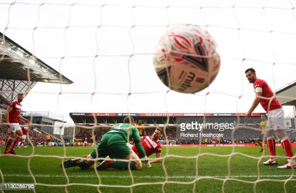 Goalkeeper Frank Fielding and Tomas Kalas of Bristol City fails to stop Ivan Cavaleiro of Wolverhampton Wanderers from scoring his team's first goal...