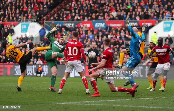 Goalkeeper Frank Fielding of Bristol City has his shot blocked by fellow goalkeeper John Ruddy of Wolverhampton Wanderers during the FA Cup Fifth...