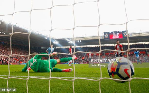 Goalkeeper Fraser Forster of Southampton fails to stop Isaac Hayden of Newcastle United from scoring their first goal during the Premier League match...