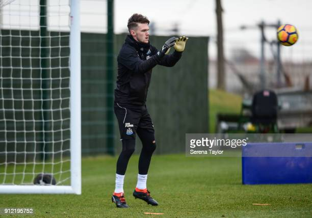 Goalkeeper Freddie Woodman catches the ball during The Newcastle United Training session at The Newcastle United Training Centre on January 30 in...