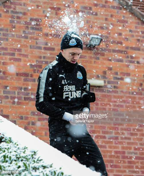Goalkeeper Freddie Woodman is hit in the head with a snowball during the Newcastle United Training session at the Newcastle United Training Centre on...