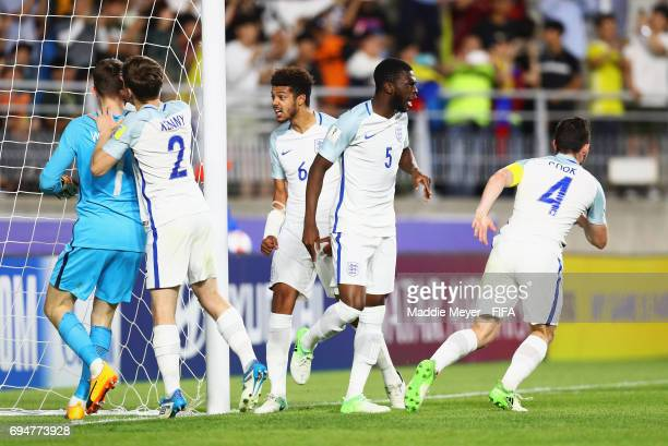 Goalkeeper Freddie Woodman of England is congratulated as he saves a penalty from Adalberto Penaranda of Venezuela during the FIFA U20 World Cup...