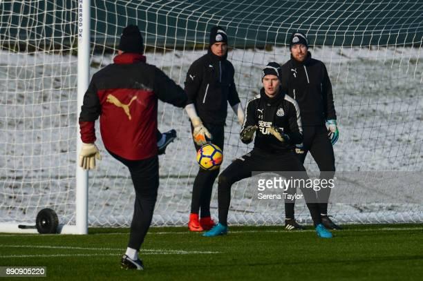 Goalkeeper Freddie Woodman sets himself to make a save during the Newcastle United training session at the Newcastle United Training Centre on...