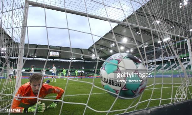 Goalkeeper Frederik Roennow of FC Schalke 04 reacts following Wolfsburg's opening goal, an own goal scored by Shkodran Mustafi of FC Schalke 04,...