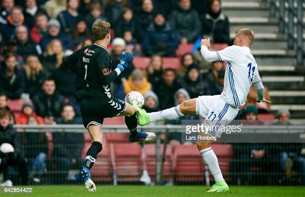 Goalkeeper Frederik Ronnow of Brondby IF and Andreas Cornelius of FC Copenhagen compete for the ball during the Danish Alka Superliga match between...