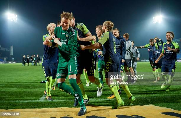 Goalkeeper Frederik Ronnow of Brondby IF and his team mates celebrate after the Danish Alka Superliga match between Hobro IK and Brondby IF at DS...