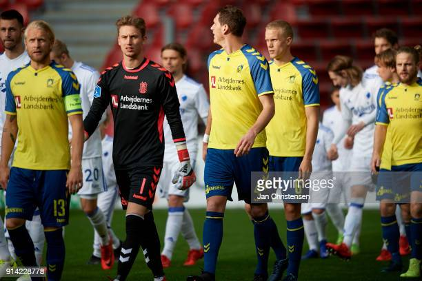 Goalkeeper Frederik Ronnow of Brondby IF and team mates walk on to the pitch prior to the Danish Cup DBU Pokalen match between FC Copenhagen and...