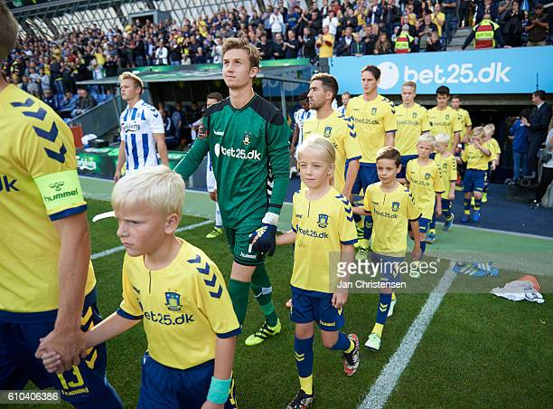 Goalkeeper Frederik Ronnow of Brondby IF and teammates walk on to the pitch prior to the Danish Alka Superliga match between Brondby IF and OB Odense...