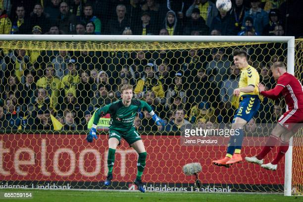 Goalkeeper Frederik Ronnow of Brondby IF looks as the ball is headed away by Gregor Sikosek of Brondby IF the Danish Alka Superliga match between...