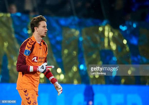 Goalkeeper Frederik Ronnow of Brondby IF prepares for the second half during the Danish Alka Superliga match between FC Midtjylland and Brondby IF at...