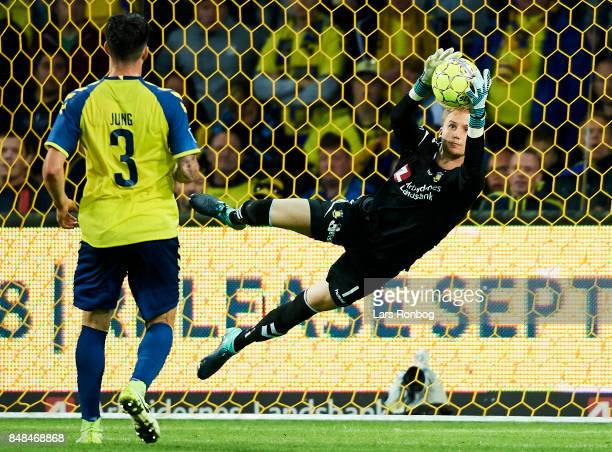 Goalkeeper Frederik Ronnow of Brondby IF saves the ball during the Danish Alka Superliga match between Brondby IF and AaB Aalborg at Brondby Stadion...