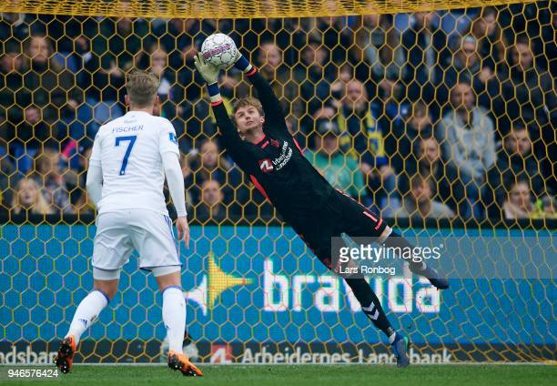Goalkeeper Frederik Ronnow of Brondby IF saves the ball during the Danish Alka Superliga match between Brondby IF and FC Copenhagen at Brondby...