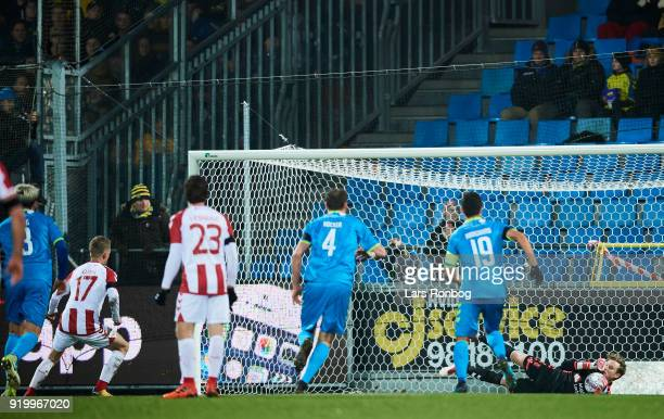 Goalkeeper Frederik Ronnow of Brondby IF saves the penalty kick from Kasper Kusk of AaB Aalborg during the Danish Alka Superliga match between AaB...