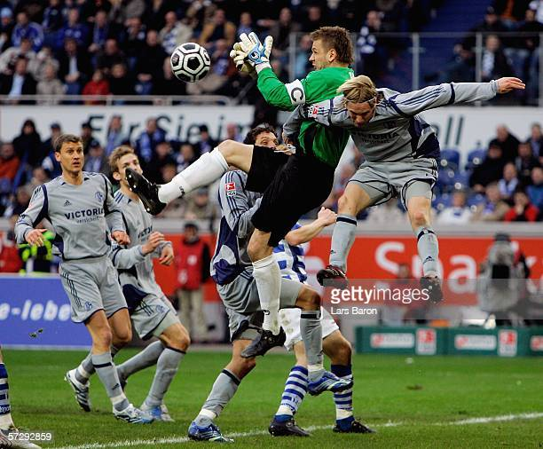 Goalkeeper Georg Koch of Duisburg in action with Christian Poulsen of Schalke during the Bundesliga match between MSV Duisburg and FC Schalke 04 at...