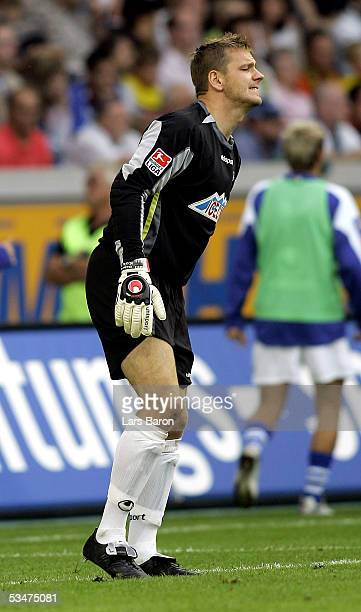 Goalkeeper Georg Koch of Duisburg leaves injured the pitch during the Bundesliga match between MSV Duisburg and Borussia Dortmund at the MSV Arena on...