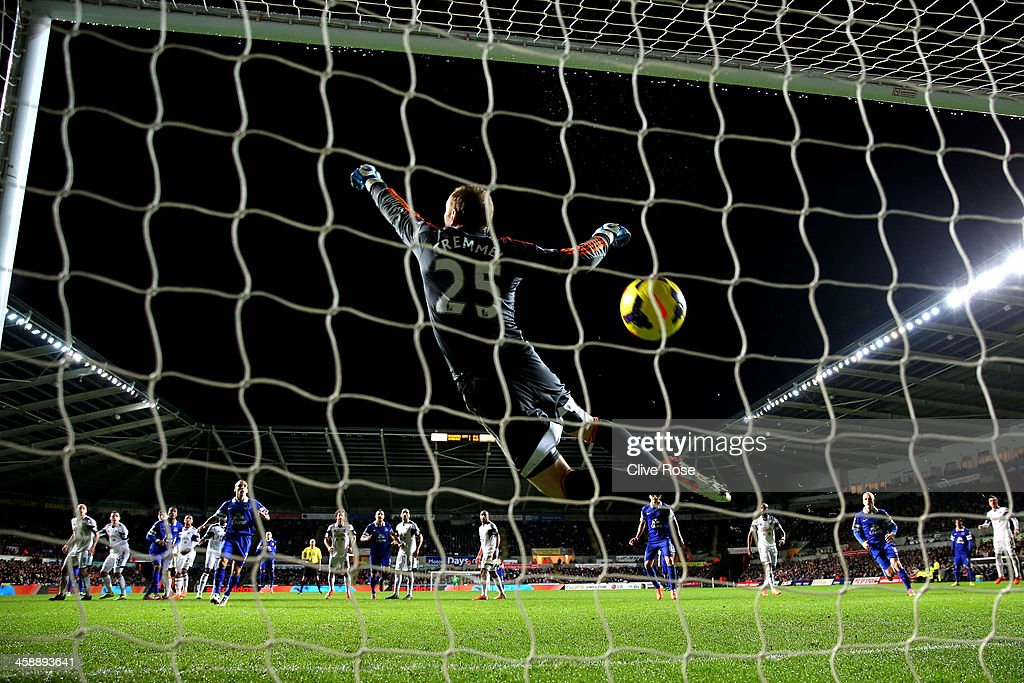 Goalkeeper Gerhard Tremmel of Swansea dives in vain as the freekick from Ross Barkley of Everton flies into the net for the matchwinning goal during the Barclays Premier League match between Swansea City and Everton at the Liberty Stadium on December 22, 2013 in Swansea, Wales.