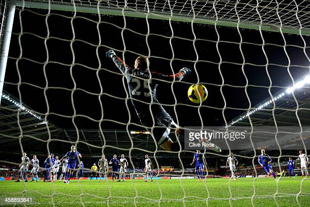 Goalkeeper Gerhard Tremmel of Swansea dives in vain as the freekick from Ross Barkley of Everton flies into the net for the matchwinning goal during...