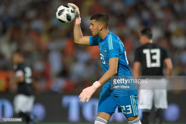 Goalkeeper Geronimo Rulli of Argentina controls the ball during a friendly match between Argentina and Mexico at Malvinas Argentinas Stadium on...
