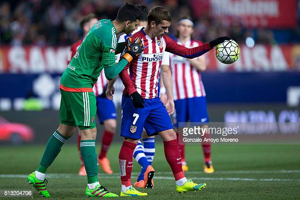 Goalkeeper Geronimo Rulli of Real Sociedad de Futbol speaks with Antoine Griezmann of Atletico de Madrid before shooting his penalty shot during the...