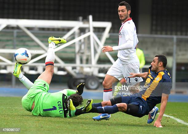 Goalkeeper Gianluca Curci of Bologna FC makes a save at the feet of Bosko Jankovic of Hellas Verona during the Serie A match between Hellas Verona FC...