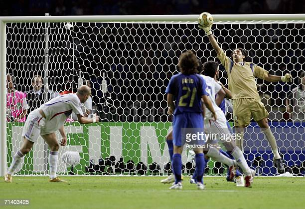 Goalkeeper Gianluigi Buffon of Italy saves the attempt on goal by Zinedine Zidane of France during the FIFA World Cup Germany 2006 Final match...