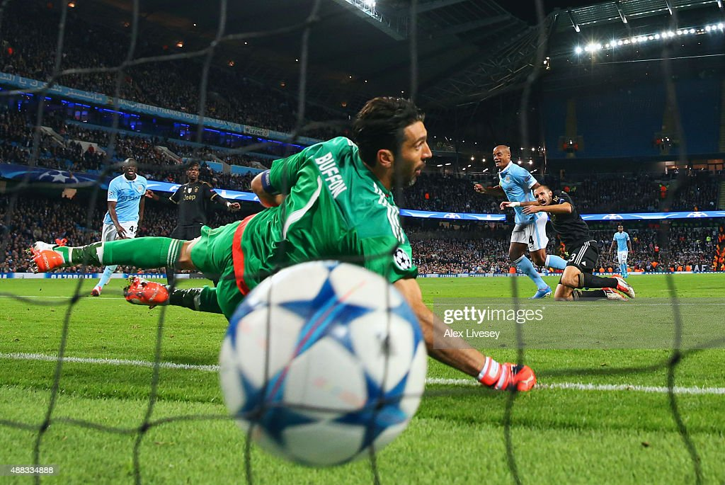 Goalkeeper Gianluigi Buffon of Juventus dives in vain as Vincent Kompany of Manchester City pressures Giorgio Chiellini of Juventus into scoring an own goal for their first during the UEFA Champions League Group D match between Manchester City FC and Juventus at the Etihad Stadium on September 15, 2015 in Manchester, United Kingdom.