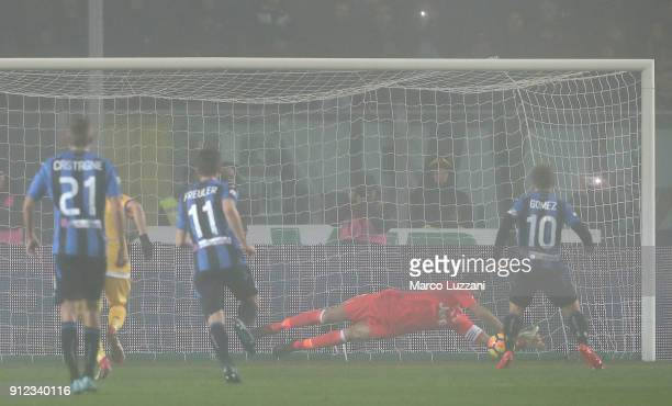 Goalkeeper Gianluigi Buffon of Juventus FC saves a penaltykick of Alejandro Dario Gomez of Atalanta BC during the TIM Cup match between Atalanta BC...