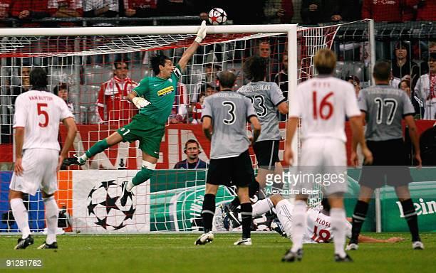 Goalkeeper Gianluigi Buffon of Juventus saves a shot of Miroslav Klose of Muenchen during the UEFA Champions League Group A match between FC Bayern...