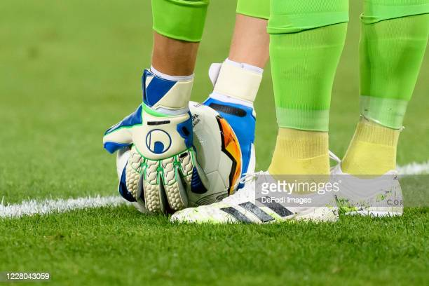 Goalkeeper gloves are seen lifting a ball during the UEFA Europa League Quarter Final between Manchester United and FC Kobenhavn at...