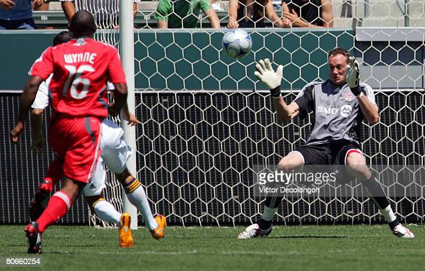 Goalkeeper Greg Sutton of Toronto FC makes a save against Landon Donovan of the Los Angeles Galaxy in the first half during their MLS game at the...