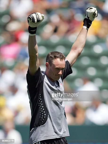 Goalkeeper Greg Sutton of Toronto FC raises his arms after teammate Jeff Cunningham scored the goahead eventual gamewinning goal late in the second...
