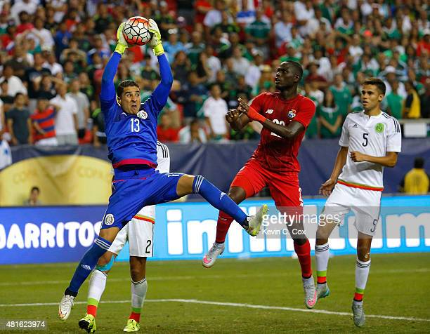 Goalkeeper Guillermo Ochoa of Mexico save a shot on goal against Abdiel Arroyo of Panama during the 2015 CONCACAF Golf Cup Semifinal match between...