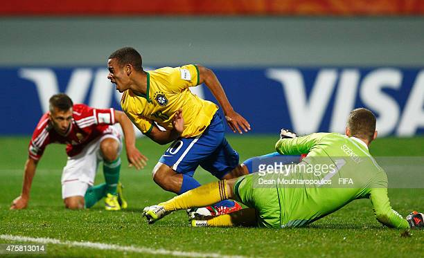 Goalkeeper Gyorgy Szekely of Hungary tackles and fouls Gabriel Jesus of Brazil to give away a penalty in the final minutes of the game during the...