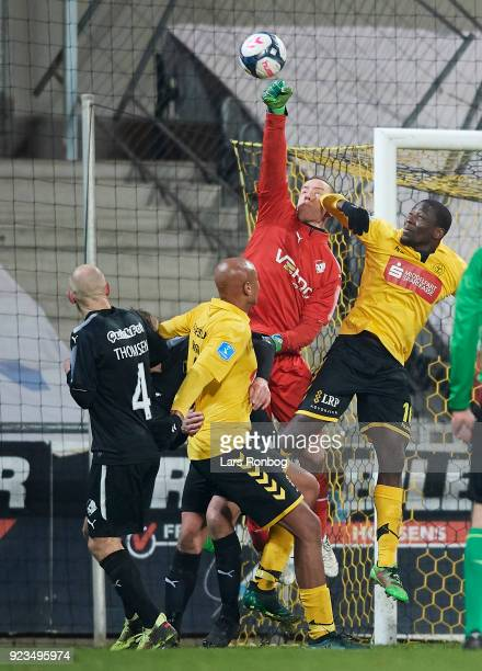Goalkeeper Hannes Thor Halldorsson of Randers FC and Delphin Tshiembe of AC Horsens compete for the ball during the Danish Alka Superliga match...