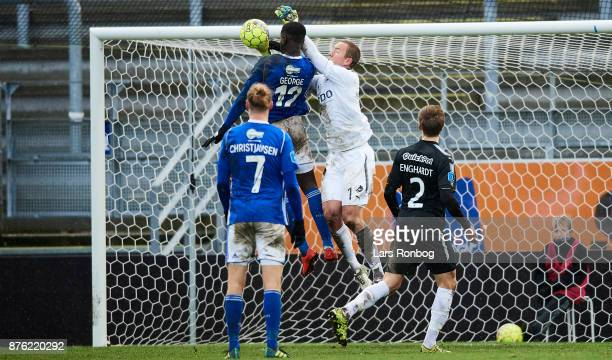 Goalkeeper Hannes Thor Halldorsson of Randers FC and Mayron George of Lyngby BK compete for the ball during the Danish Alka Superliga match between...