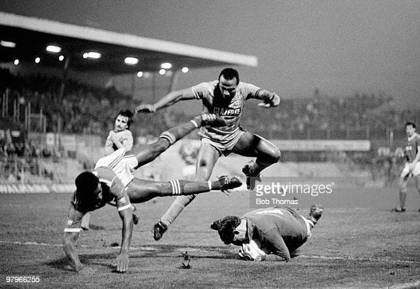 Goalkeeper Hans Segers of Nottingham Forest collects the ball as teammate Chris Fairclough and Cyrille Regis of Coventry City leap over him during...