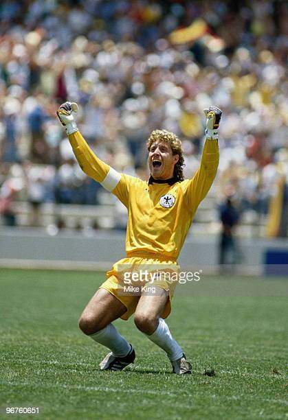 Goalkeeper Harald Schumacher of West Germany celebrates a goal against Scotland during the 1986 FIFA World Cup Group E match on 8 June 1986 at the La...