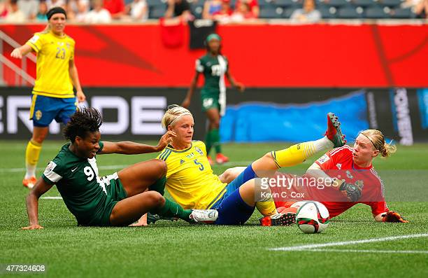 Goalkeeper Hedvig Lindahl and Nilla Fischer of Sweden defend a shot attempt by Desire Oparanozie of Nigeria during the FIFA Women's World Cup Canada...