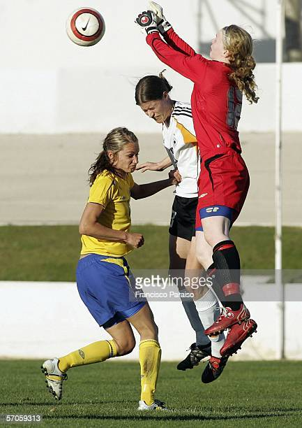 Goalkeeper Hedvig Lindahl of Sweden and Kerstin Garefrekes of Germany jump for the ball during the Womens Algarve Cup match between Germany and...