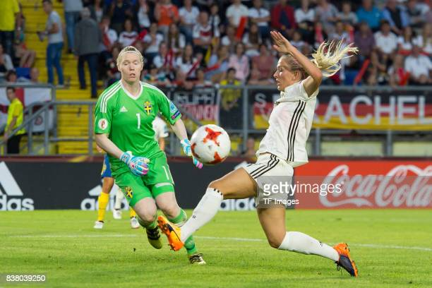 Goalkeeper Hedvig Lindahl of Sweden and Mandy Islacker of Germany battle for the ball l during the Group B match between Germany and Sweden during...