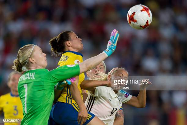 Goalkeeper Hedvig Lindahl of Sweden Jonna Andersson of Sweden and Mandy Islacker of Germany battle for the ball l during the Group B match between...