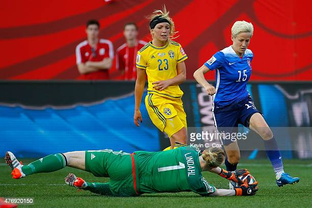 Goalkeeper Hedvig Lindahl of Sweden makes a save against Megan Rapinoe of the United States in the second half in the FIFA Women's World Cup Canada...