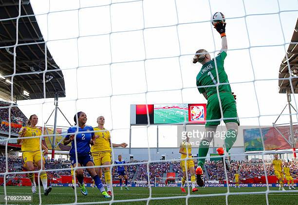 Goalkeeper Hedvig Lindahl of Sweden makes a save against the United States in the FIFA Women's World Cup Canada 2015 match at Winnipeg Stadium on...
