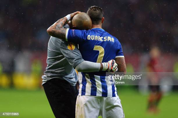 Goalkeeper Helton and Ricardo Quaresma of Porto celebrate during the UEFA Europa League Round of 32 second leg match between Eintracht Frankfurt and...