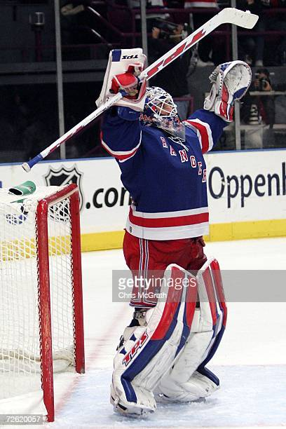 Goalkeeper Henrik Lundqvist of the New York Rangers celebrates their victory over the Carolina Hurricanes of the New York Rangers November 21 2006 at...