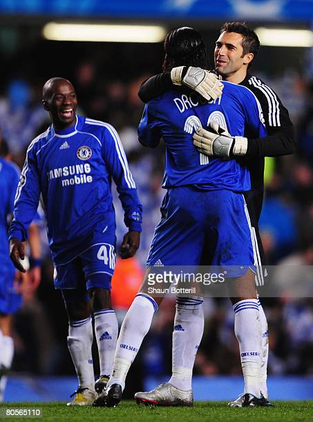 Goalkeeper Henrique Hilario of Chelsea hugs Didier Drogba of Chelsea as team mate Claude Makelele of Chelsea looks on after the UEFA Champions League...