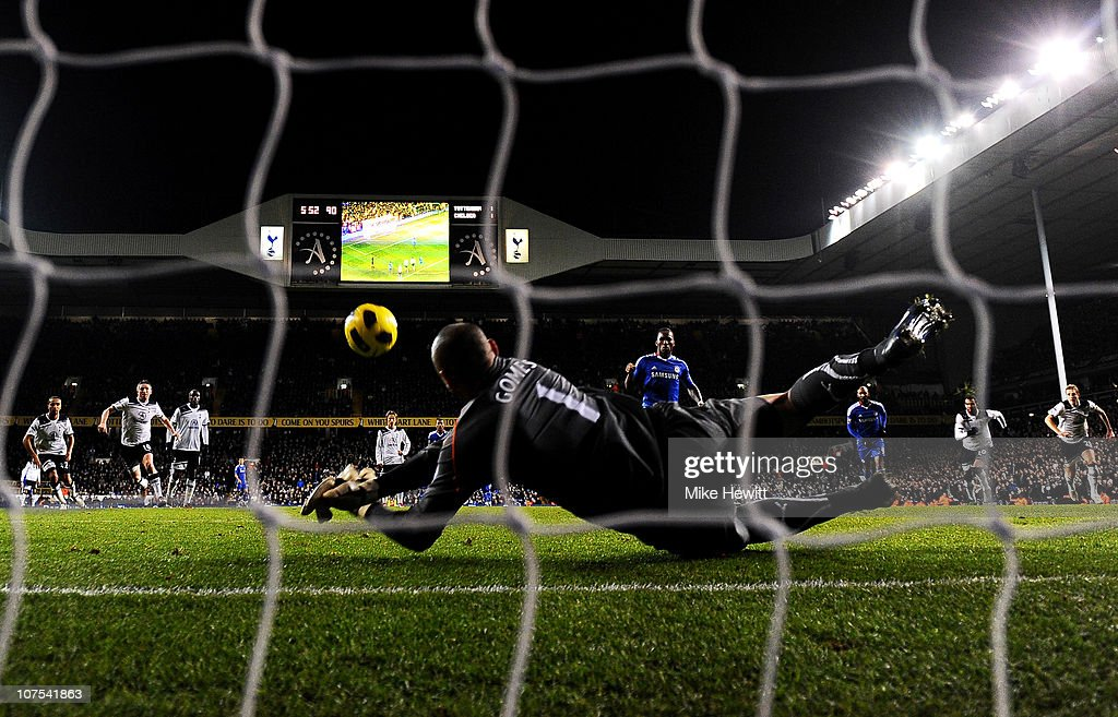 Goalkeeper Heurelho Gomes of Spurs saves the penalty from Didier Drogba of Chelsea to keep the score at 1-1 during the Barclays Premier League match between Tottenham Hotspur and Chelsea at White Hart Lane on December 12, 2010 in London, England.