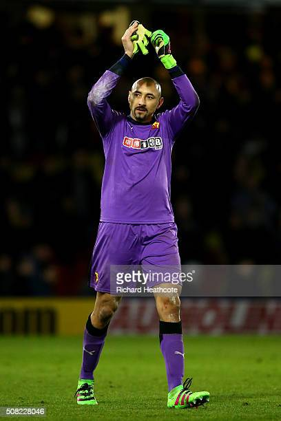 Goalkeeper Heurelho Gomes of Watford applauds the home fans following the 00 draw during the Barclays Premier League match between Watford and...